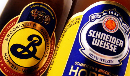 Both variants of the Brooklyn/Schneider Hopfen Weisse in their beautifully designed bottles