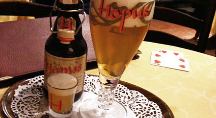 Hopus beer from Belgium, served with a shot glass of yeast residue.