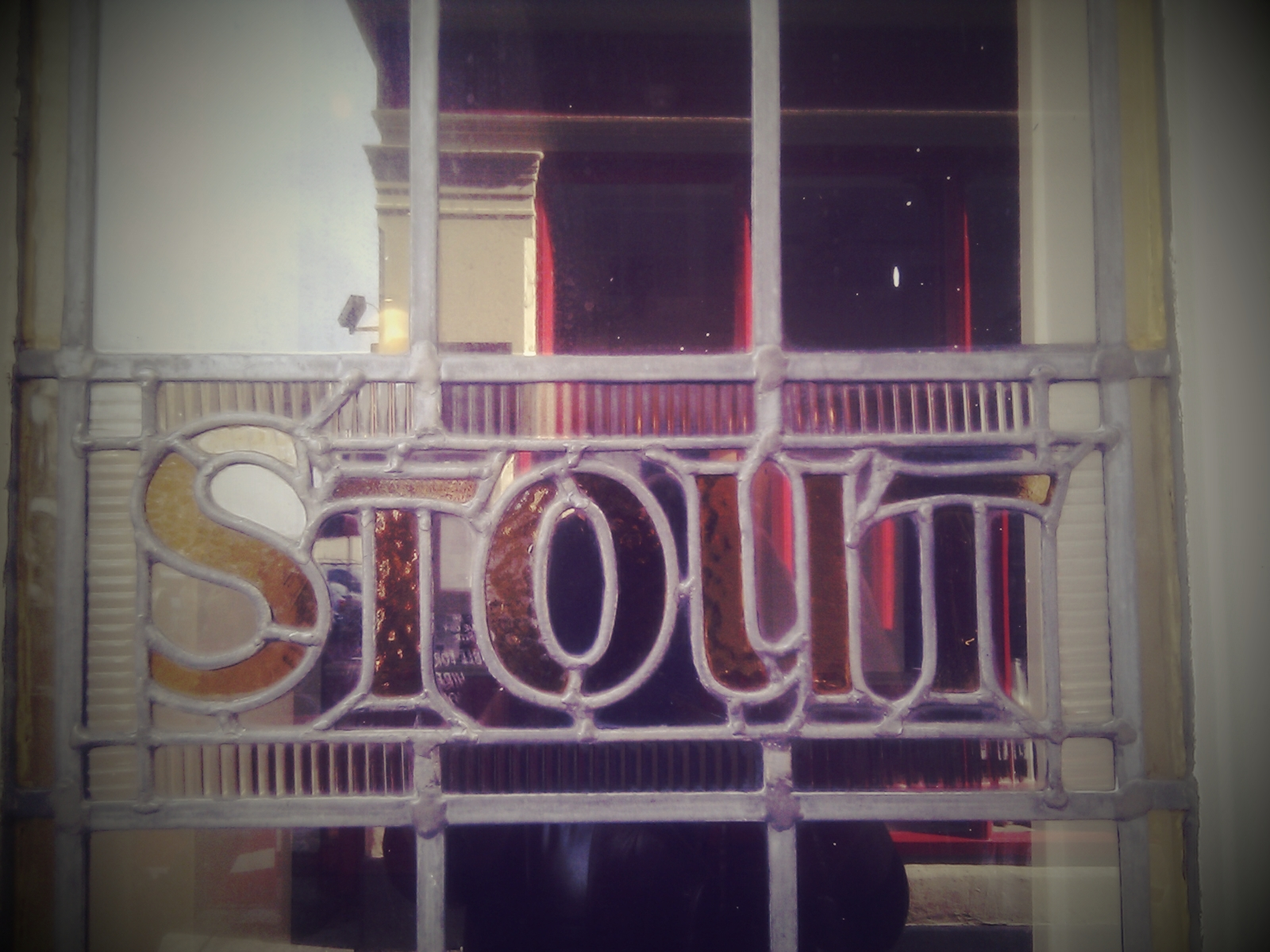 "Stained glass pub window reading ""Stout"""