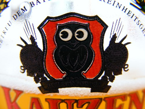 Kauzen beer glass with owl logo.