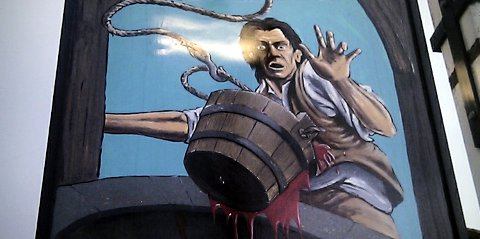 Pub sign for the Bucket of Blood
