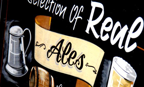 Sign advertising real ale in London, 2007.