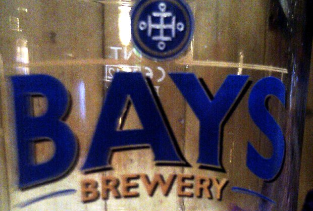 Beer glass with Bays Brewery logo.