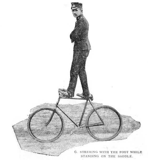 A man balancing on a bicycle.