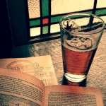 Beer and a book in an atmospheric pub.