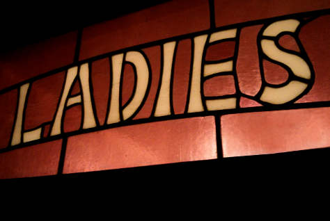 Ladies sign in a pub.
