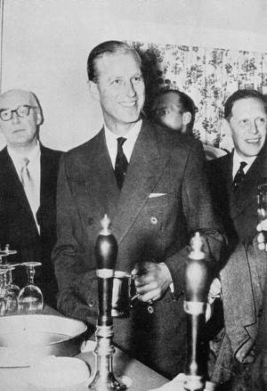 The Duke of Edinburgh drinks at the Britannia Inn, Copenhagen, 1955.