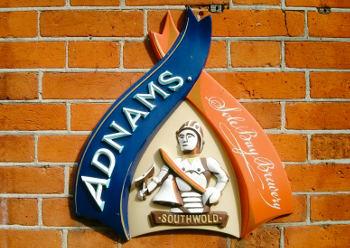 Adnams's shield on a pub wall.