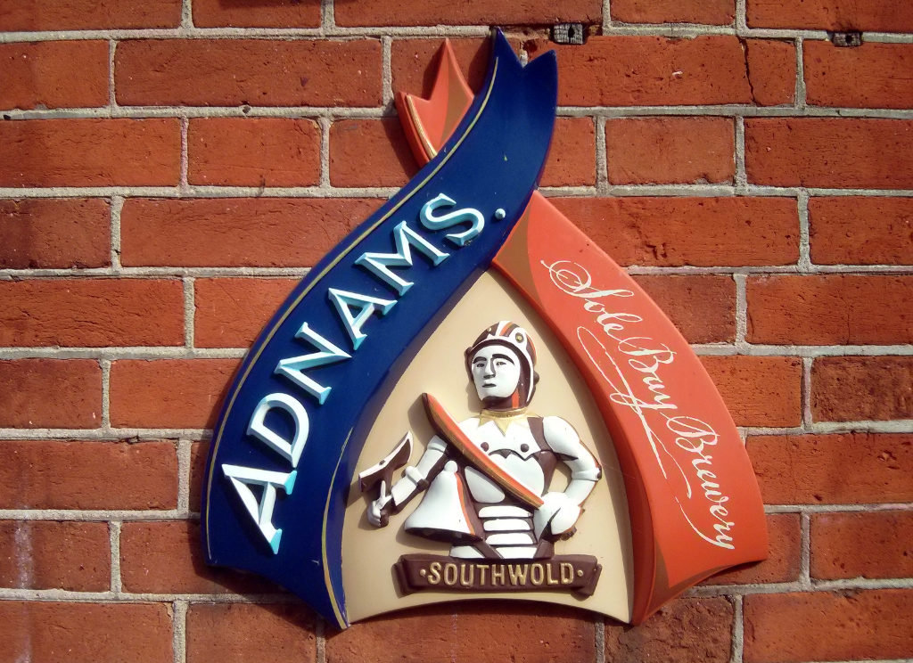 Adnams's shield on a pub wall.