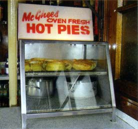 McGhees Oven Fresh Hot Pies at the Laurieston Bar, 2009, by John Gorevan.