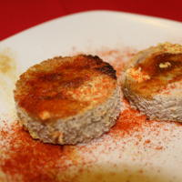 Buttered, spiced toast rounds.