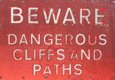 SIGN: 'Beware: Dangerous Cliffs and Paths.'