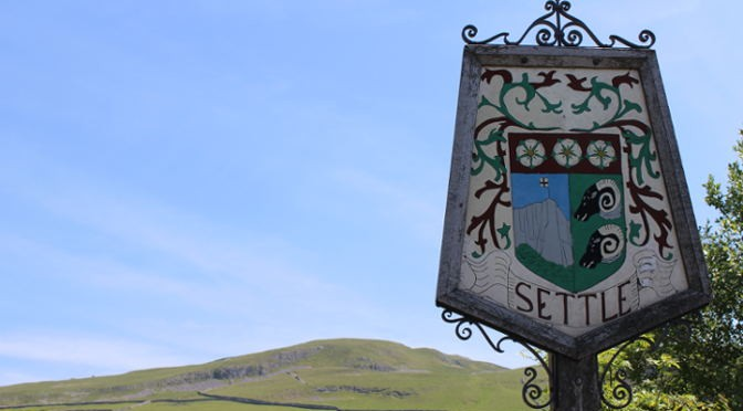 Sign welcoming visitors to Settle, North Yorkshire.