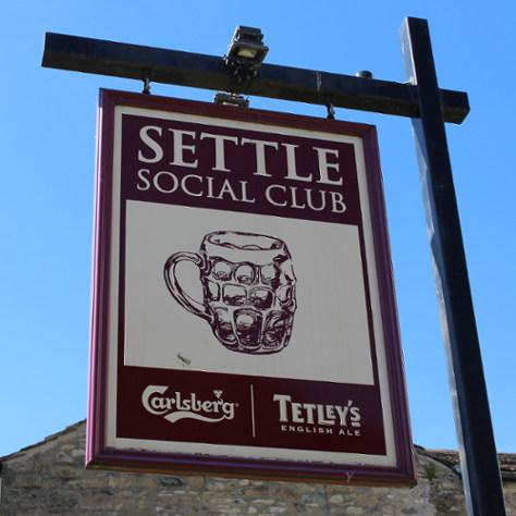 Settle Social Club sign.