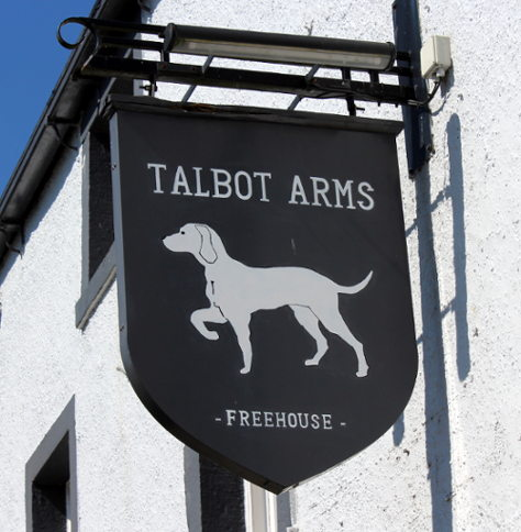 Talbot Arms sign: a white dog in hunting pose.