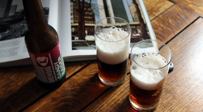 BrewDog Candy Kaiser: bottle, two glasses, and a vintage book about West Germany.