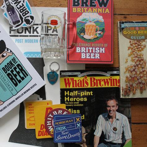 Prize bundle feat. Mikkeller book, Brew Britannia, Watney's half-pint glass, BrewDog keyring &c.