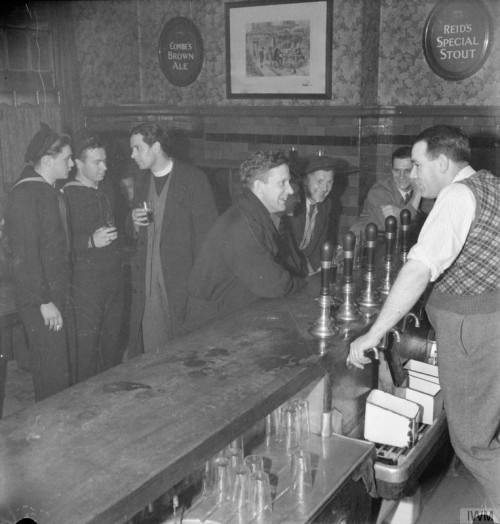 A sparse pub; soldiers; landlord; signs on the wall.
