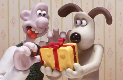 Wallace & Gromit with a chunk of cheese.