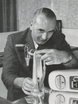 A technician tinkers with a Guinness font.