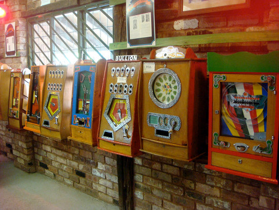 A line of vintage slot machines.