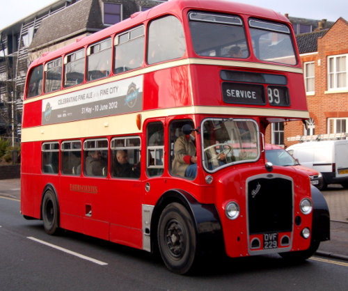 Red Routemaster bus with Norwich City of Ale livery.
