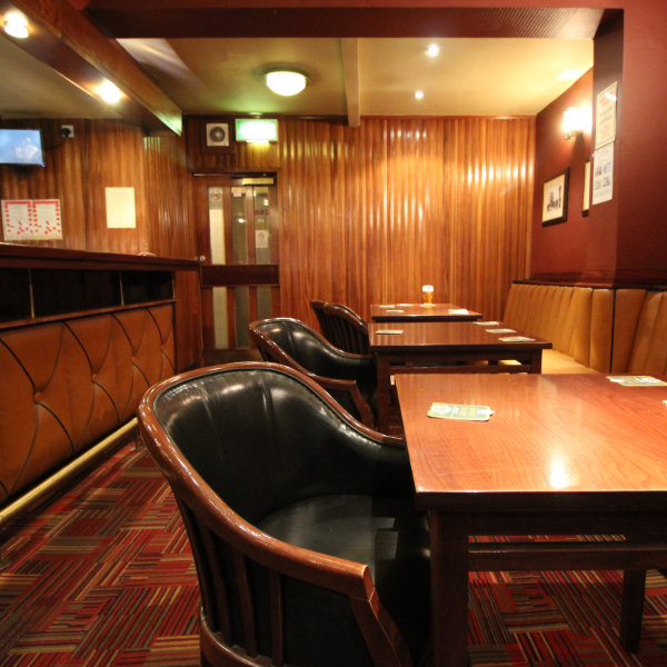 Lounge bar with carpets and wood panelling.