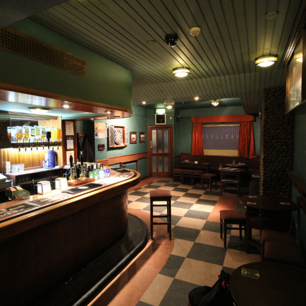 Public bar with tiles and painted walls.