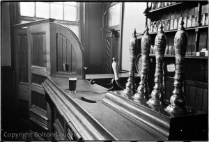 Black-and-white photo: beer pumps without clips.