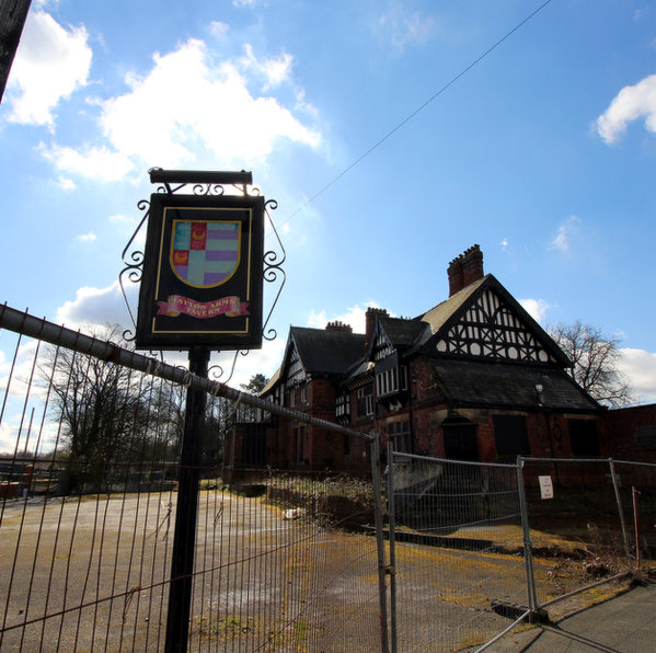 Tatton Arms, half-collapsed, behind security fencing.