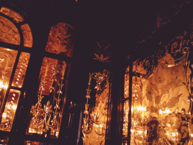 Cut glass mirrors at the Red Lion reflecting orange light.