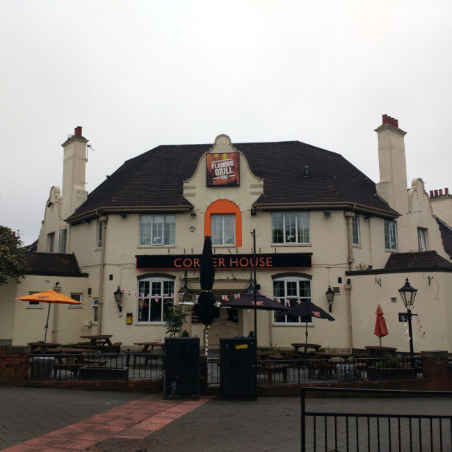 An inter-war improved pub with 'Flaming Grill' branding.