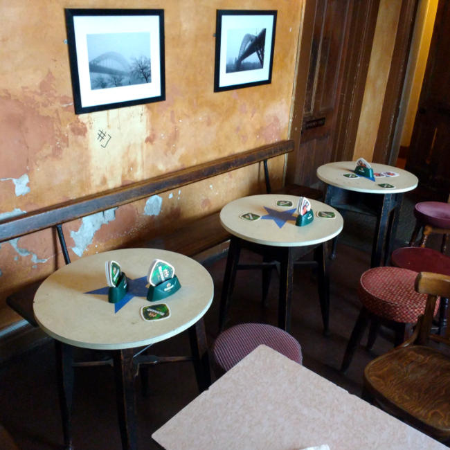 Newcastle Breweries branded Formica tables.