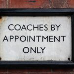 "SIGN: ""Coaches by Appointment Only""."