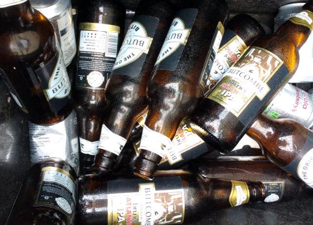 Butcombe bottles in a recycling bin.
