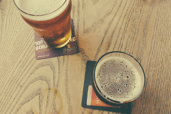 Two beers from 45 degrees, with beer mats.