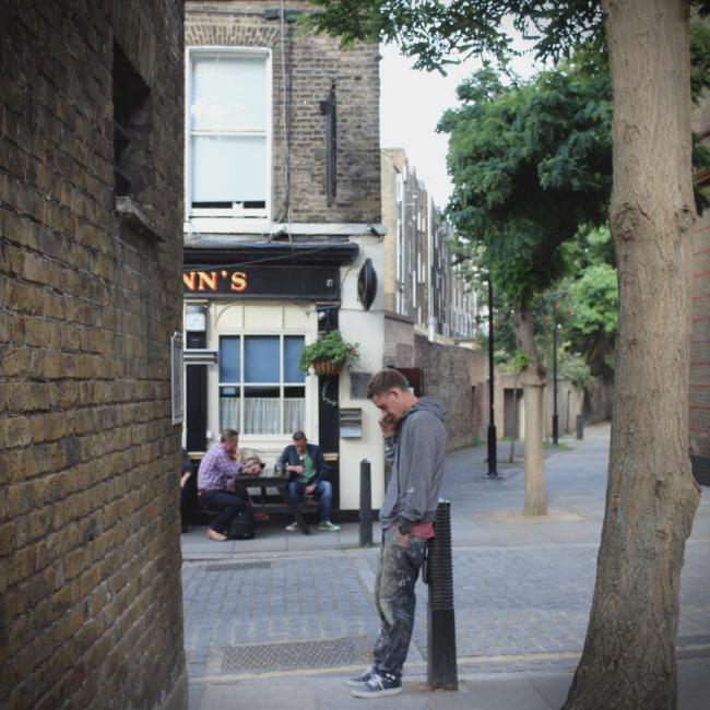 A London pub glimpsed up an alleyway.