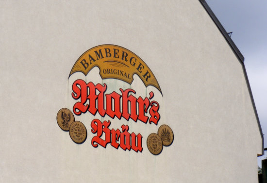 Painted Mahr's sign on a wall in Bamberg.