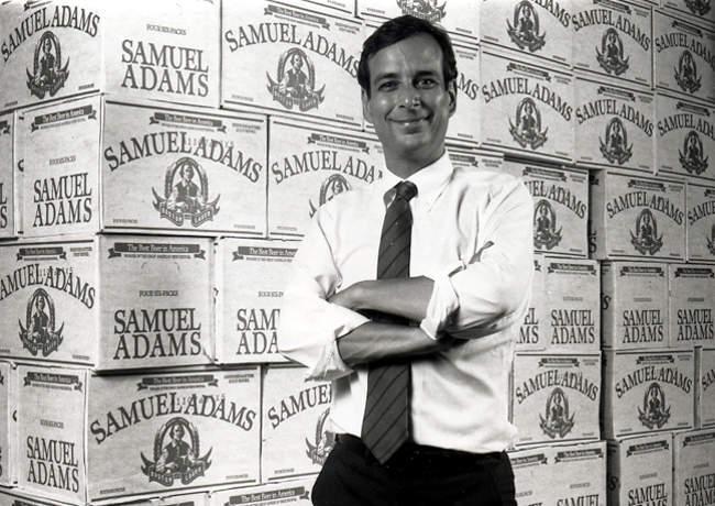 In front of cases of beer.