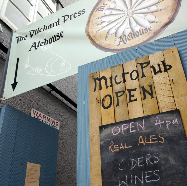 Signs on the gate: 'Micropub Open 4pm.'
