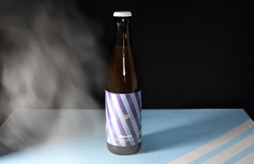 A bottle of Cloudwater V 10 enveloped in steam.