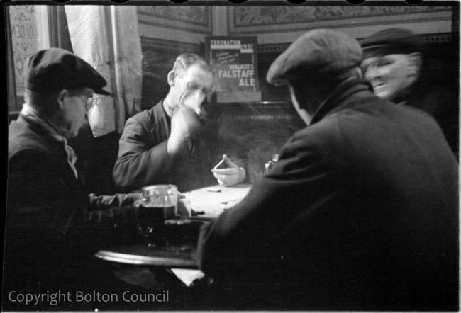 Men playing dominoes.