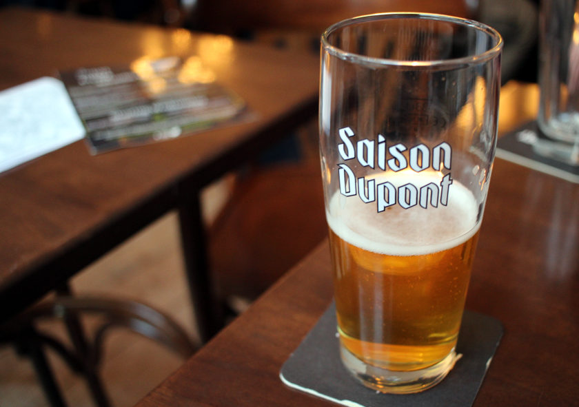 Saison Dupont in branded glass.