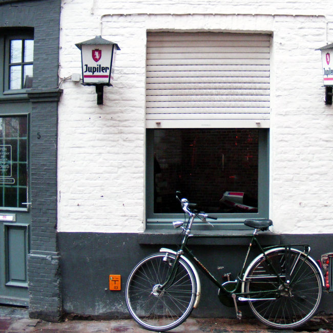 A bicycle outside a bar in Bruges, 2010.