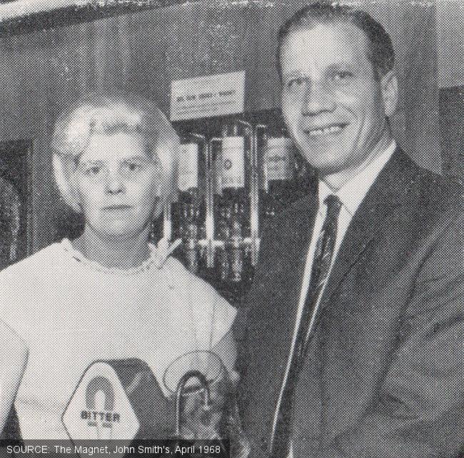 Mr and Mrs Elstub behind the bar.