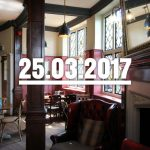 A West London pub interior with date overlaid.