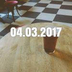 A pint of beer on a pub table with date overlaid.