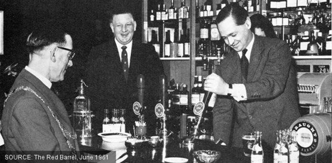 George Mann pulls a pint.