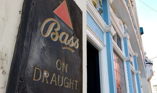 Bass on Draught plaque outside an English pub.