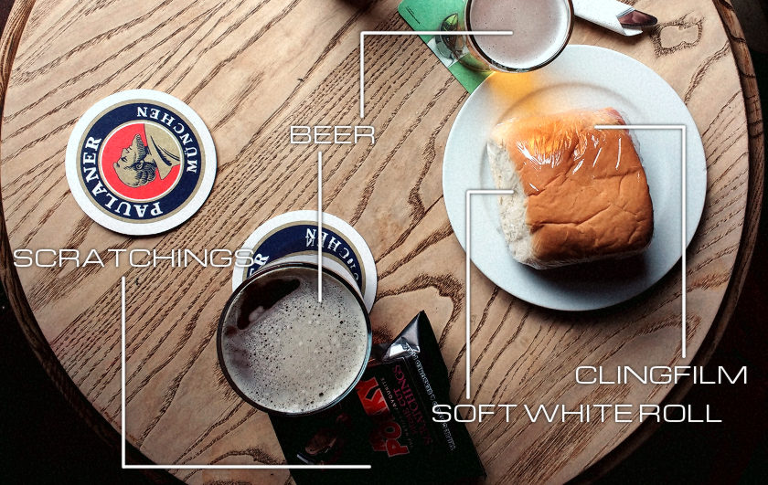 Ham roll on a pub table.